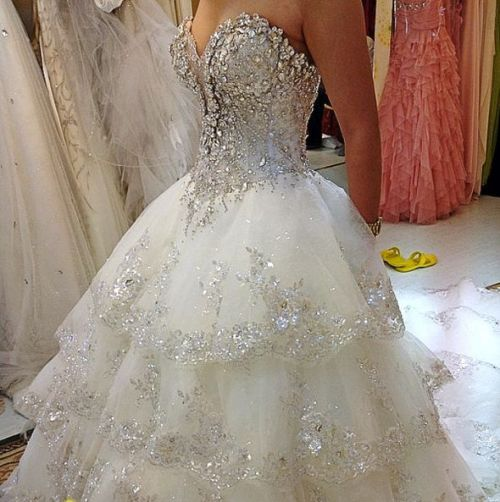 sweetheart neckline wedding dress with a lot of bling