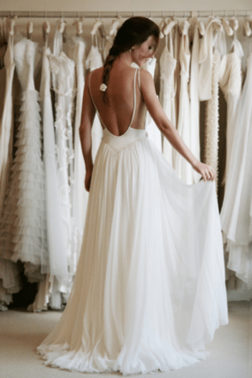 white simple wedding dress with a low back