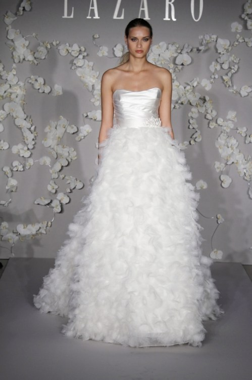 Lazaro a-line strapless wedding dress with feathers