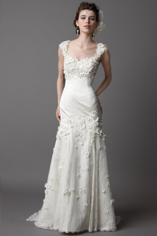 lace open back wedding dress with flowers and chapel train accent
