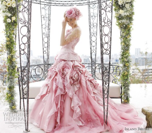 pink ball gown wedding dress with flower accent