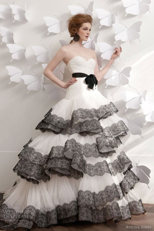 wedding dress with black lace trim by atelier aimee