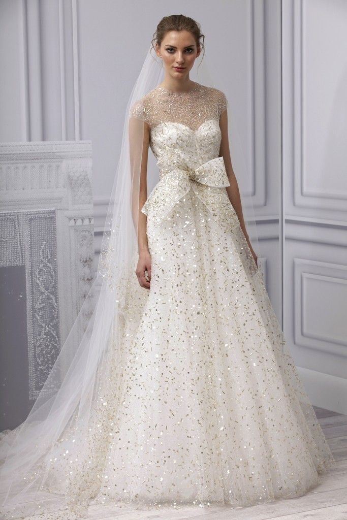 a-line wedding dress with cap sleeves and gold embellishment