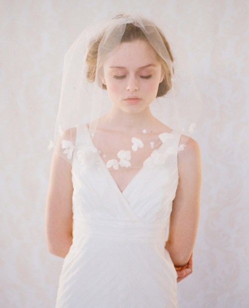 simple ivory wedding veil over face