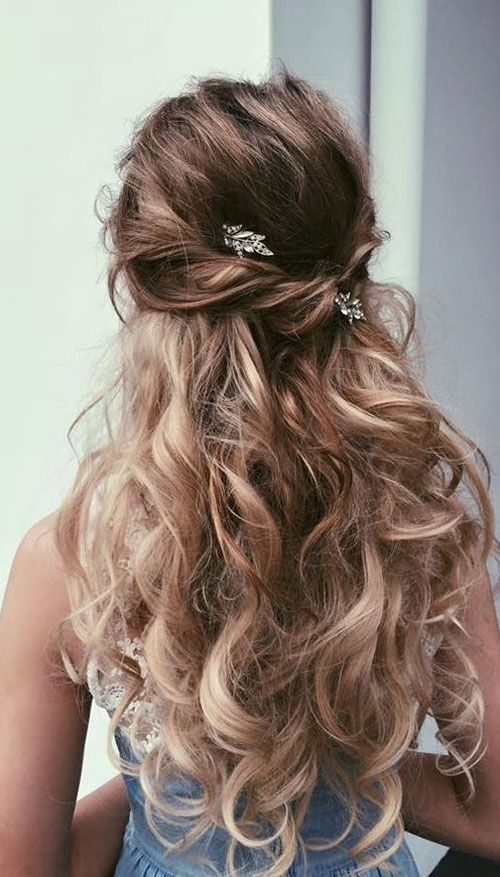 prom long blond hairstyle down with floral accessory