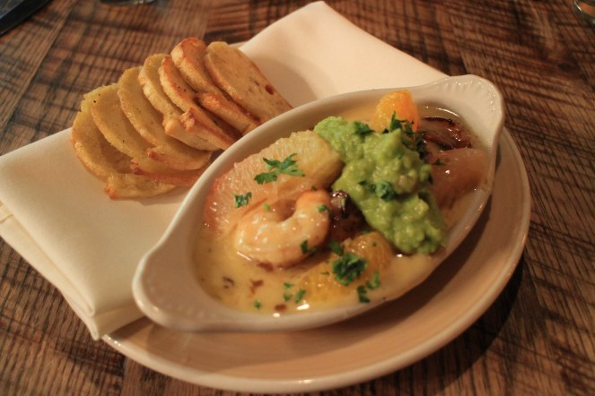 Garlic shrimp in creamy sauce with raw grapefruit and orange, cilantro and guacamole