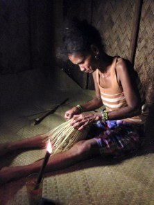 10, IP woman weaving basket with wooden torch