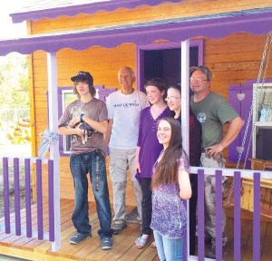 """Dani Miner's brother Jared and Make-A-Wish representative Tom Hagerman stand to her left, her mother and father, Alana and Nathan, to the right, and her sister, Sara, in front after the Make-a-Wish Foundation granted her wish by building a """"sanctuary"""" in her back yard."""