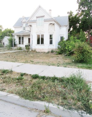 This is one of two 19th Century homes next door to each other on Main Street in Ephraim that are vacant and deteriorating. Both feature waist-high weeds in the front yards.