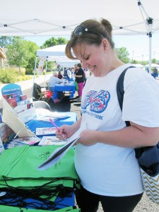 Dawn Ludvigson of Mayfield takes some notes at a booth on diabetes at the Gunnison Valley Family Health and Safety Fair last Saturday.