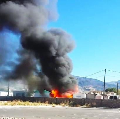 From a distance, the fire that incinerated two Ephraim trailers appears as a towering inferno. Families believe the fire started on the porch of one trailer and crossed to the other, but investigators say it's too early to say what caused the blaze.