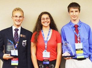 Manti High Kyler Nelson, left, and Hyrum Malone, right, hold their awards after competing in the Future Business Leaders of America competition in Atlanta, Ga. over the summer. Kjerstin Birch, center, competed in public speaking.