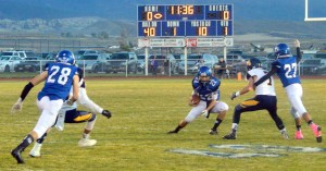 Gunnison senior Kyler White jukes on a play during Friday night football last week against Summit Academy. Gunnison matched well with the Bears, but lost in a shootout, 60-40. - Photo courtesy Kaden Leon