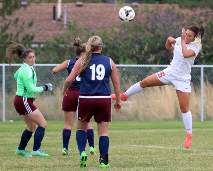 Caylie Olson goes high to head the ball for a goal on a corner kick in Manti's 8-0 win over North Sevier