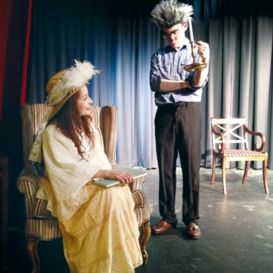 """Whitney Hill (seated) of Manti plays Mother Goose as she argues with Gatlin Jordan of Moroni, who is both the Big Bad Wolf and Ebenezer Scrooge, in the North Bend Entertainers production of """"A Fairy Tale Christmas Carol."""" - Bryan Spencer / Messenger photo"""