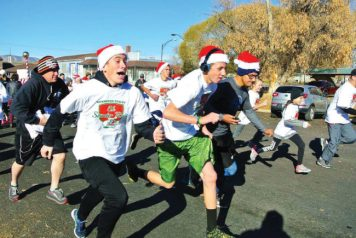 The Santa Run in Gunnison had enthusiastic participants, sprinting their way towards the finish line. - Tom Osmond / Messenger photo