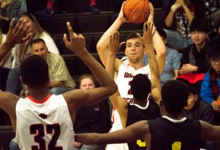 Senior Jeff Baradziej tries to get a pass to teammate Bernardo DaSilva (No.32) during the Tigers' game against the Academy of Sports Science last Friday. It was a defensive shutdown day from the Tigers, who won 79-37. - Photo courtesy Kyler Daybell