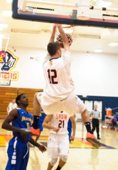 Sophomore Nate Bruneel smashed this alley-oop home against Hillcrest Academy last Friday. Bruneel had 19 points in the 129-60 win. - Matt Harris / Messenger photo