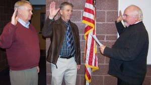 Paul Gottfredson swears in Kim Pickett (left) as South Sanpete School Board president for two years and Grant Hansen (center) as a new board member during the recent school board meeting in Manti.