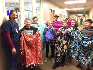 Boy Scouts from Troop 502 delivered handmade fleece blankets for the new babies at Sanpete Valley Hospital. Pictured from left to right are Nursery Supervisor Elaine McCormick, Caden Smith, Karson Lowe, Dimick Huntington, Jentry Whitman, Morgan Stevens, Payden Wintch, Macklin Lee and Josh Madsen. - Daniela Vazquez / Messenger photo