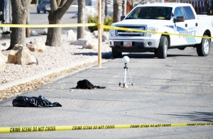 This spots marks where the body of 21-year old Ricardo Valencia of Gunnison was found dead on Tuesday morning. In the foreground is a plastic evidence bag, and behind the bag is a blanket that was soaked with the victim's blood. The globe on a tripod is part of a digital forensics scanning system brought in to help catalog crime scenes.