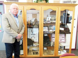 Gunnison Valley Middle School Principal Alan Peterson stands in front of a showcase where the school keeps a World War II memorial which compliments an online historical archive the school maintains on its website. - Jaycie Nordell / Messenger photo