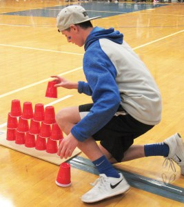 Gunnison Valley High student gingerly places a plastic cup to help form a pyramid in the cup-staking competition during the Spirit Bowl. Gunnison Valley won the event.