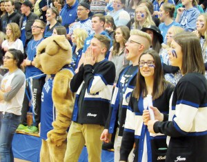 Gunnison student body officers, along with the school's costumed mascot, cheer on their school's competitors in the second Spirit Bowl held Jan. 21 at Gunnison Valley High.