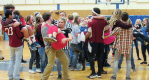 In one competition in the Spirit Bowl known as Lover's Leap, competitors, on signal, had to pick up and hold their partners in their arms.
