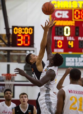 This photo from last year's game shows Wasatch Academy's center, Jackson Rowe (No. 21, left one of the two jumping), as he attempts to tip the ball to teammate Josip Vrankic (in background) as the seventh-seeded Tigers faced the second-ranked Oak Hills Academy from Virginia