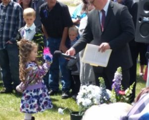 Four-year-old Sophya Lopez, who has low-spectum autism, says farewell to her mother, Kammy Edmunds, at graveside services following Edmunds' funeral. Sophya and 11-year-old brother Franky Lopez, who has high-spectrum autism (sometimes called Asperger's Syndrome) are being cared for by relatives, including their father and Edmunds' ex-husband, Donny Lopez.