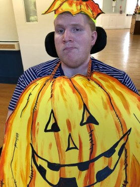 Resident dressed as a pumpkin for Halloween