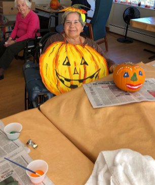 Resident dressed up as a pumpkin for Halloween