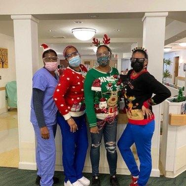 Four San Simeon staff members in Christmas attire