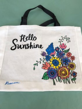 painted tote bag with flowers that says hello sunshine