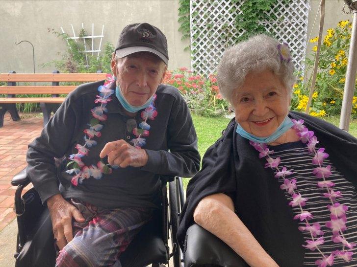 male and female San Simeon resident celebrating at a luau