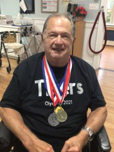 male San Simeon resident with medals from Olympic games
