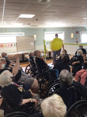 San Simeon residents playing indoor volleyball