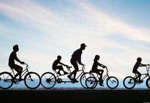 Photo of family bicycling