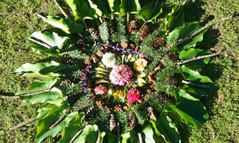 Mandala made with leaves, flowers, branches