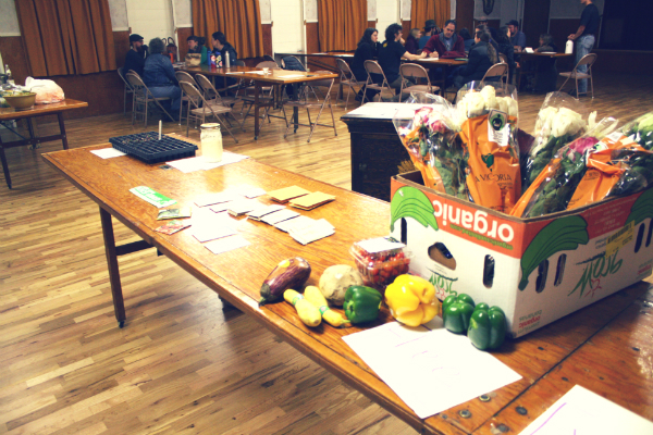 table with a box of food, seed packets, and other items