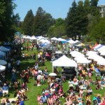 San Lorenzo Park with many tents and people during the Earth Day Festival.
