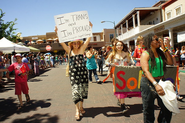 Deanna Joy Hallmark of Santa Fe, center, a transgender woman proudly marches through the plaza during the Gay pride Parade on Saturday June 28, 2014. Photo by Luke E. Montavon/The New Mexican