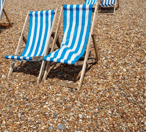 Classic seaside deckchairs on Brighton Beach