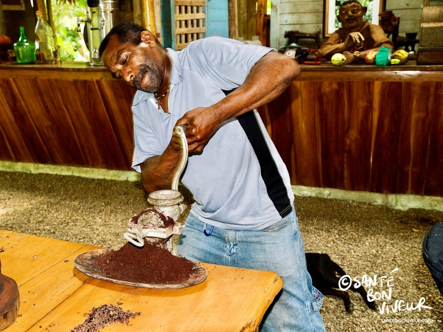 Cocoa beans being ground the old-fashioned grinder at the Chocolate Museum, Limón Province, Costa Rica. Chocolate Maker