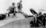 Cuban President Fidel Castro, right, loads an inner tube on a military vehicle during the evacuation of a village after Hurricane Flora in Cuba, Oct. 1963. PL