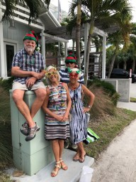 Sanibel residents Marla and Jerry Dewhirst(elf on the shelf) and Stella and Gordon Pearce in the Christmas Spirit enjoying the Captiva Golf Cart Parade
