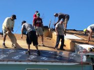 Volunteers assist with roof repairs on Green Turtle Cay