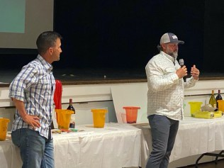 Capt. Chris Wittman (r), Program Director and founder of Captains for Clean Water and Capt. Benny Blanco of Guiding Flow TV address the crowd on the importance of viable solutions for the survival of Florida Bay and our role in it.