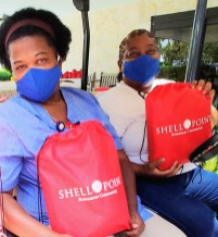 Photo 7 - Shell Point School Supply Distribution - Pavilion staff, Louise Axy and Jackie Duncan, pick up supplies